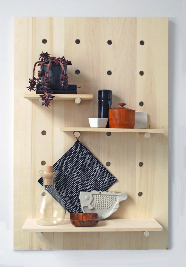 This DIY Pegboard Shelving Unit is like functional artwork. The perfect shelving unit for a small space. Found on Apartment Therapy.