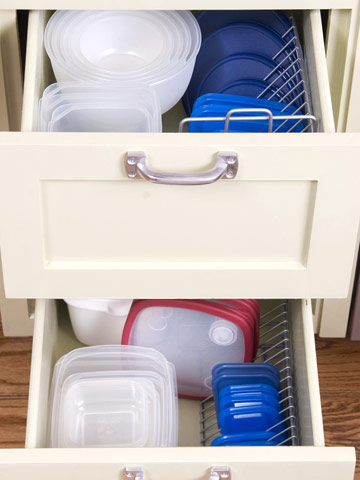 Lids. They are EVERYWHERE and so hard to find in my home. That is probably because we just toss them in a drawer. I think it's about time we changed that. Organize your lids with wire racks, found on BHG.