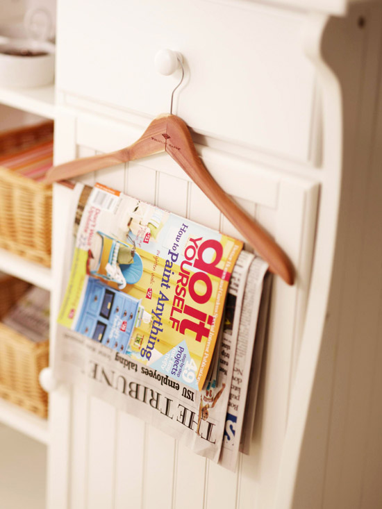 Instead of a stack of magazines you can drape your favorite reads on a wall mounted hanger! Found on BHG.
