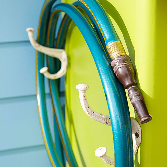 Use two vintage coat hooks to store your hose, from BHG.