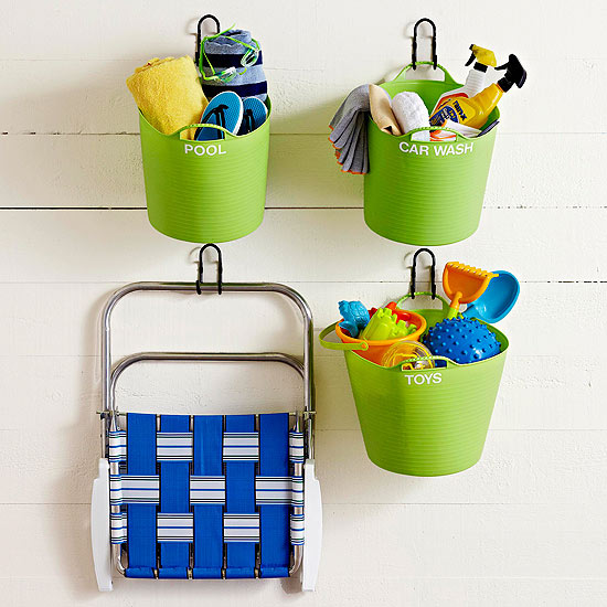 Hang some labeled plastic tubs on the wall to store kids toys and other backyard items! Found on BHG.