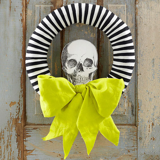 Loving this black and white striped wreath with a paper skeleton head, on Better Homes and Gardens.