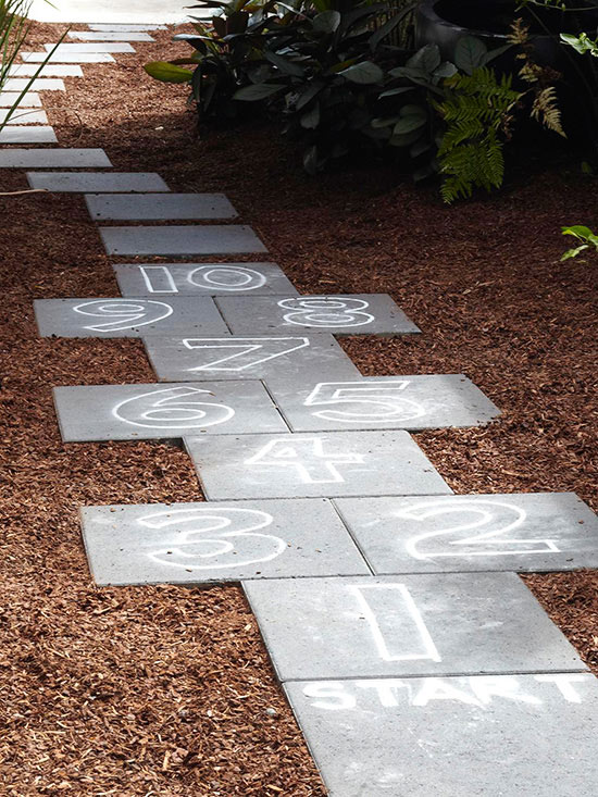 A pathway isn't just a pathway. Add some numbers to the path to make a DIY Hopscotch game for the garden. Found on BHG.