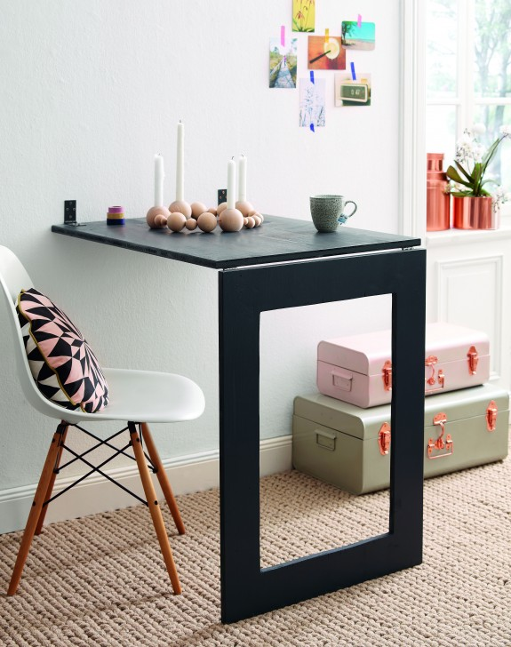 This wall mirror will fold down and turn into the perfect desk, from Home Story.