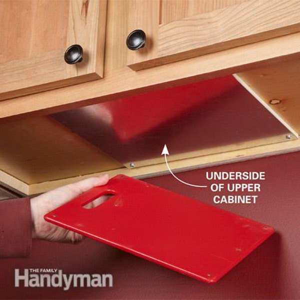 Magnetize a cutting board and you can hide just under a kitchen cabinet. Easy to get to when you need it. Found on Family Handyman.
