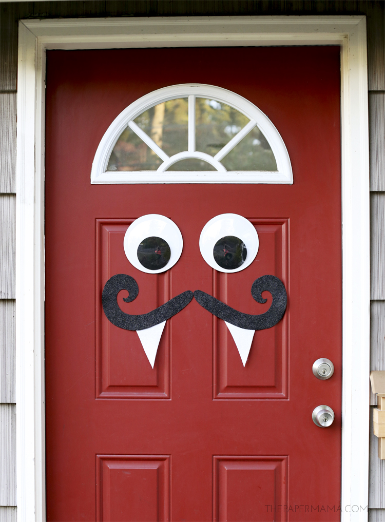 Mustache and googly eyes door decor for Halloween decorations to make at home for kids
