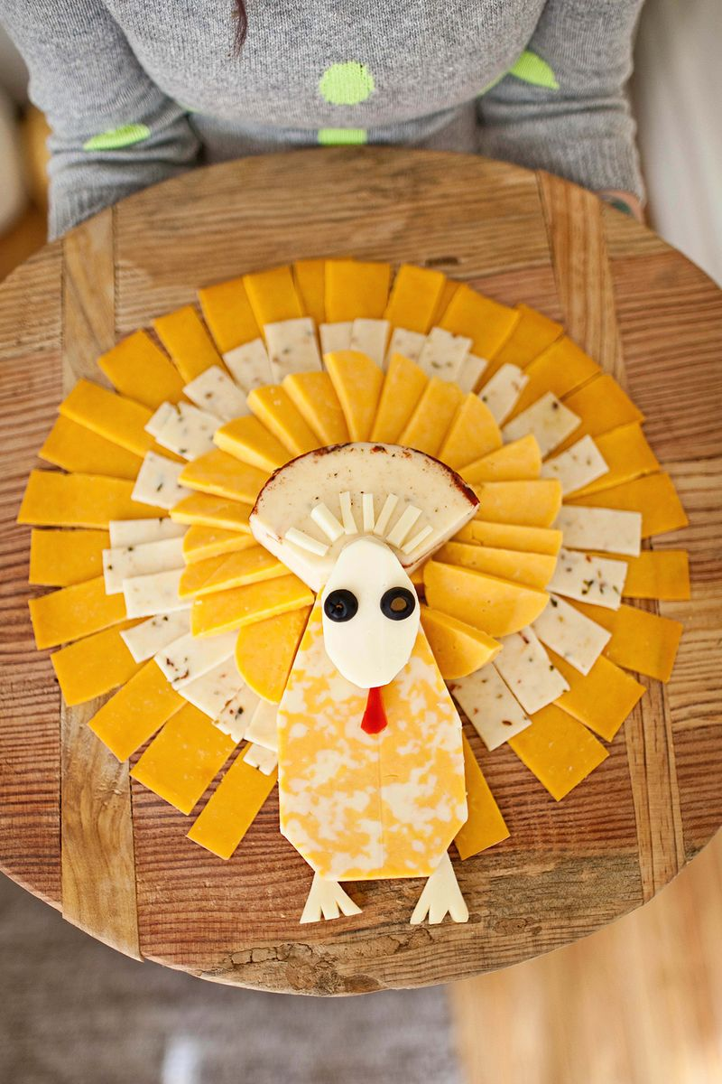 Annnnnd, since you're already making a turkey shaped fruit platter, you should probably make a turkey shaped cheese tray. Found on A Beautiful Mess.