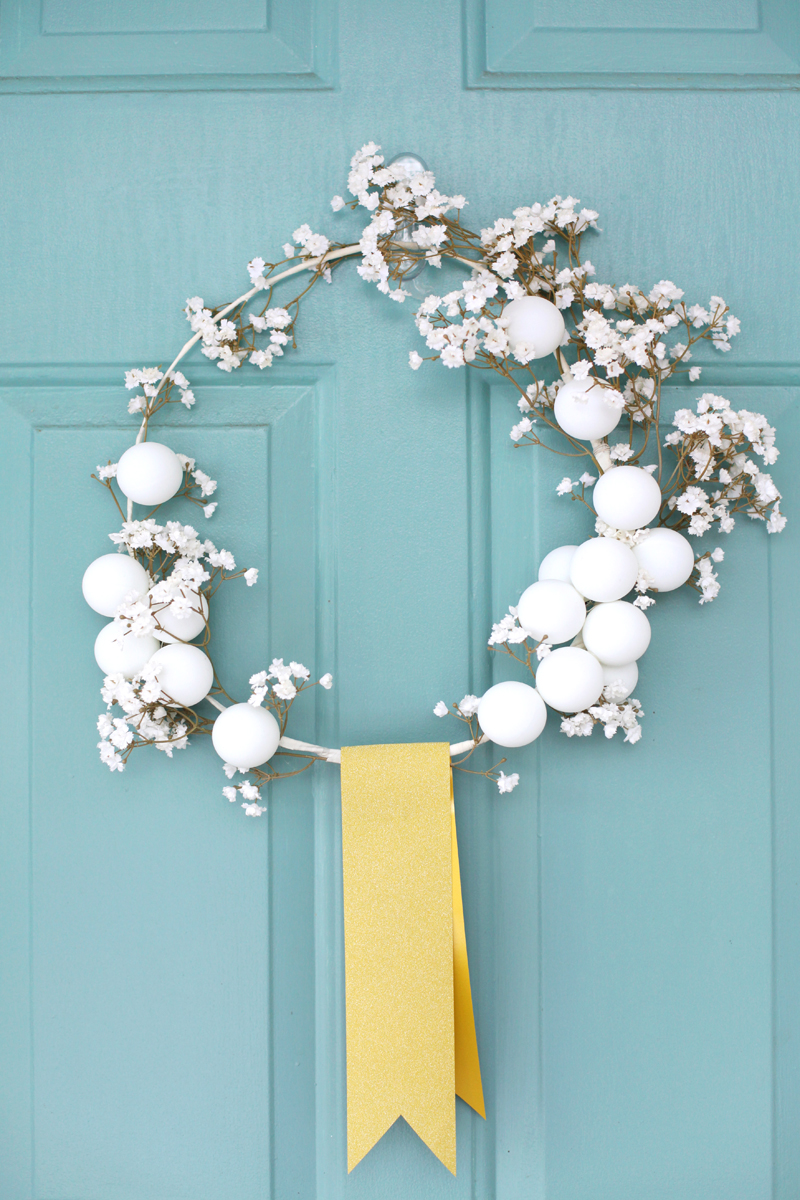 This white winter wreath is so simple and lovely, on A Beautiful Mess.