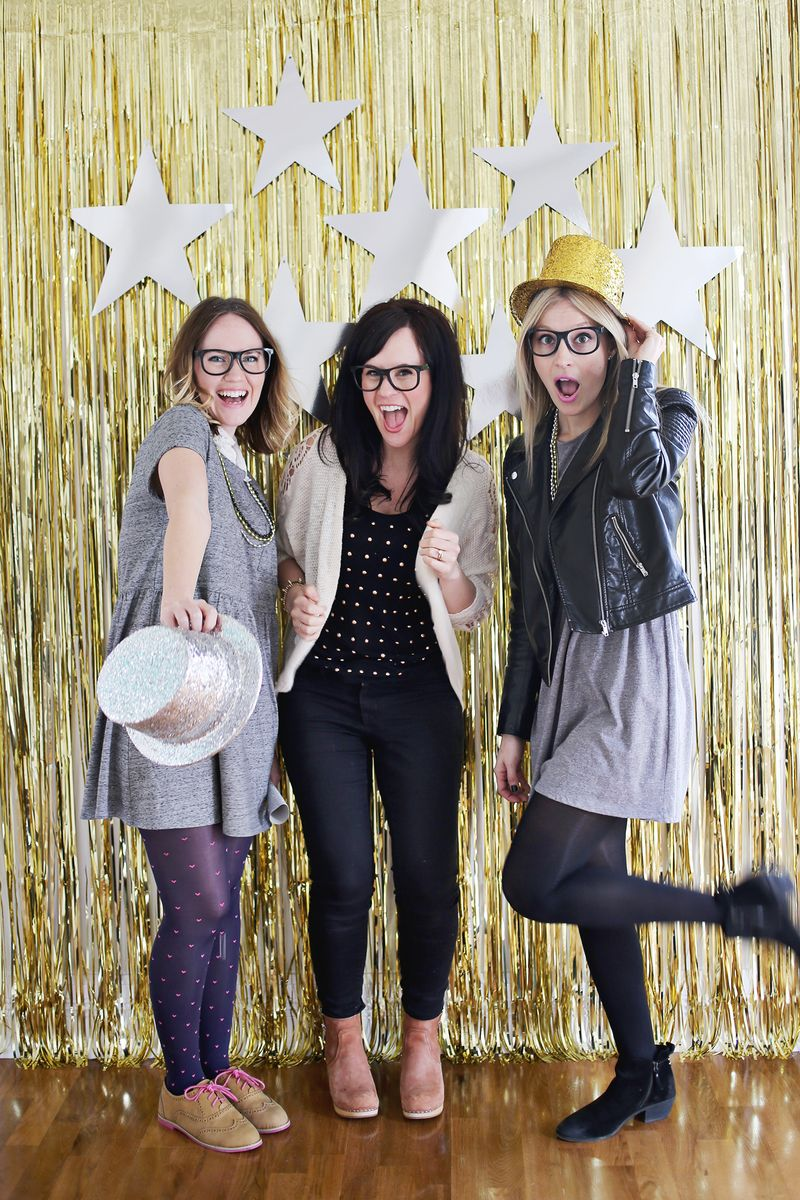 This backdrop is easy to set up with a foil door curtain and paper stars, from A Beautiful Mess.