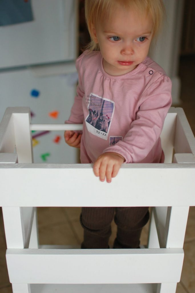 If you're a parent of a toddler you probably have a clumsy kiddo that wants to help you cook and clean. They tend to fall off most stool, but this DIY kids stool has a guard rail to keep them safe while they