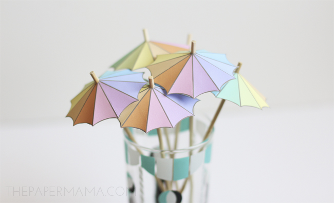 These paper umbrellas are perfect drink stirrers (comes with a free printable), on The Paper Mama.