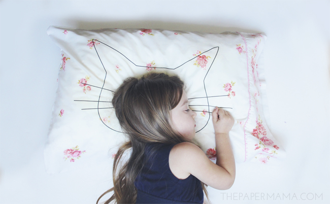 Everyone needs a pillowcase. I provided a cat shape to print out so you can make your own cat head pillowcase, from The Paper Mama.