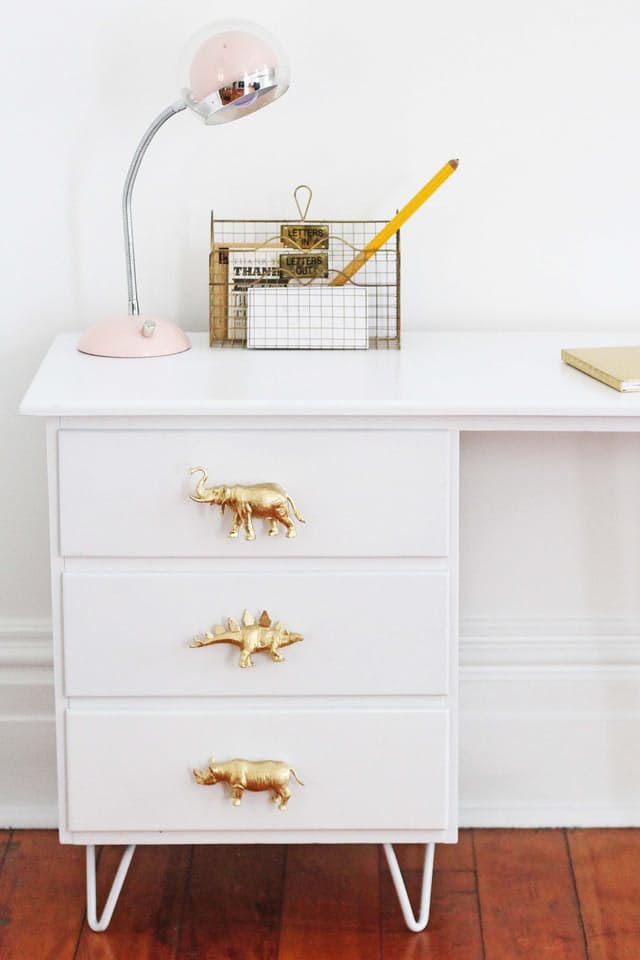 These golden animal pulls would be perfect for any kids desk! It's made using spray painted toys. Found on Apartment Therapy.