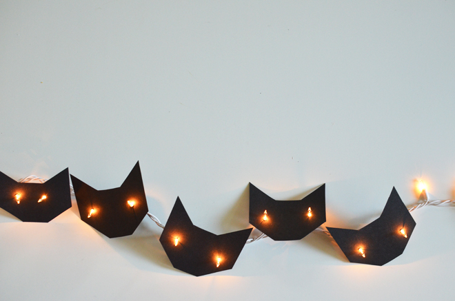 Create these cat face shaped string lights to decorate your tree, from Cakies.