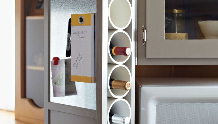 We have some special wines that we are saving, but we don't really have much space to store them. I love this vertical wine storage solution! Hide those bottles in some large pvc tubes behind a magnetic message board. Found on the Lowes blog.