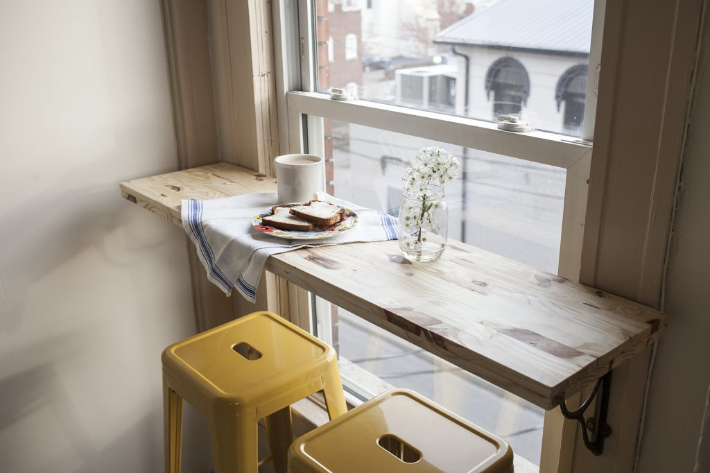 I love this little bar table by the window. It's like having a little cafe in your home. Found on Offbeat and Inspired.