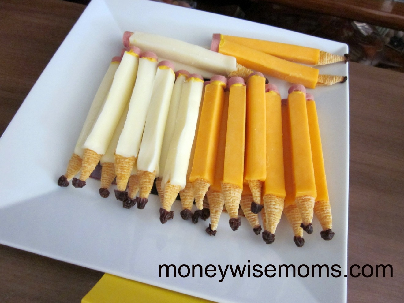 http://www.moneywisemoms.com/2011/08/string-cheese-pencils/