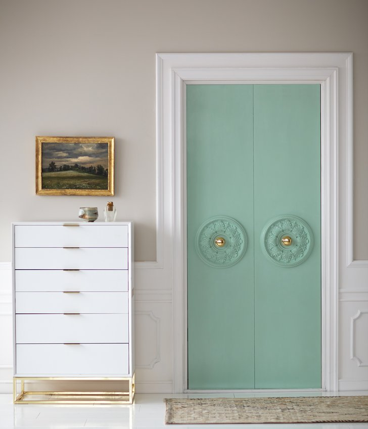 I love everything about this hardware makeover. Framing a doorknob with a ceiling medallion and adding a bit of paint is a great way to update your door's hardware. Found on Popsugar.