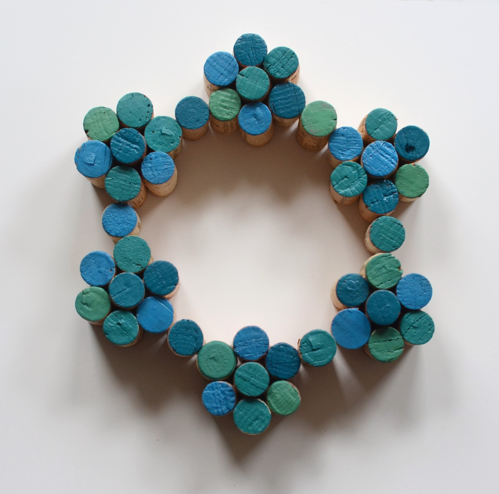 Save all those wine corks to make this fun Painted Cork Wreath, on Design Fixation.