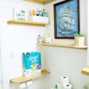 DIY Faux Floating Bathroom Shelves - corner view of shelves in bathroom.