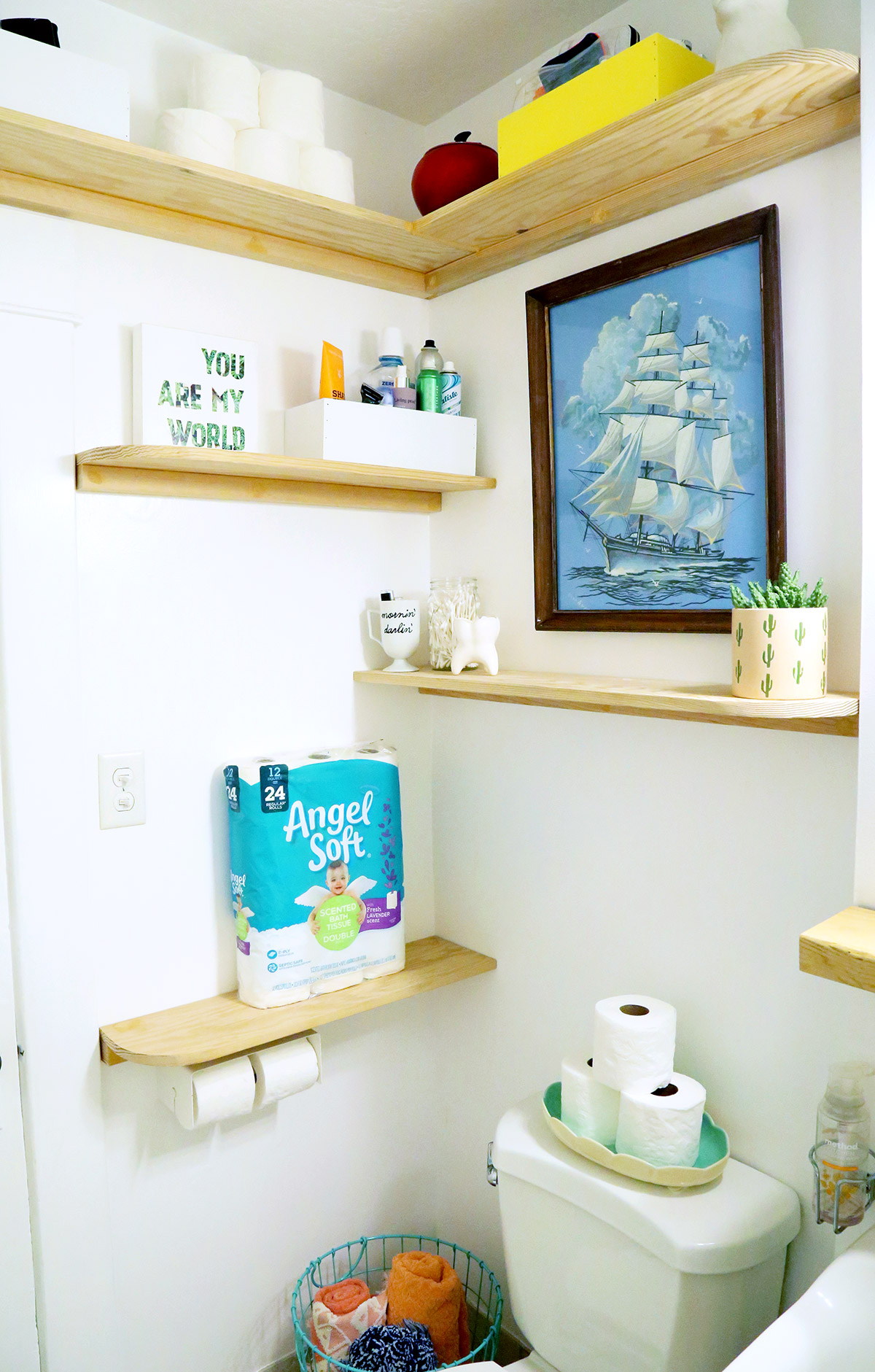 DIY Faux Floating Bathroom Shelves - corner view of shelves in bathroom.
