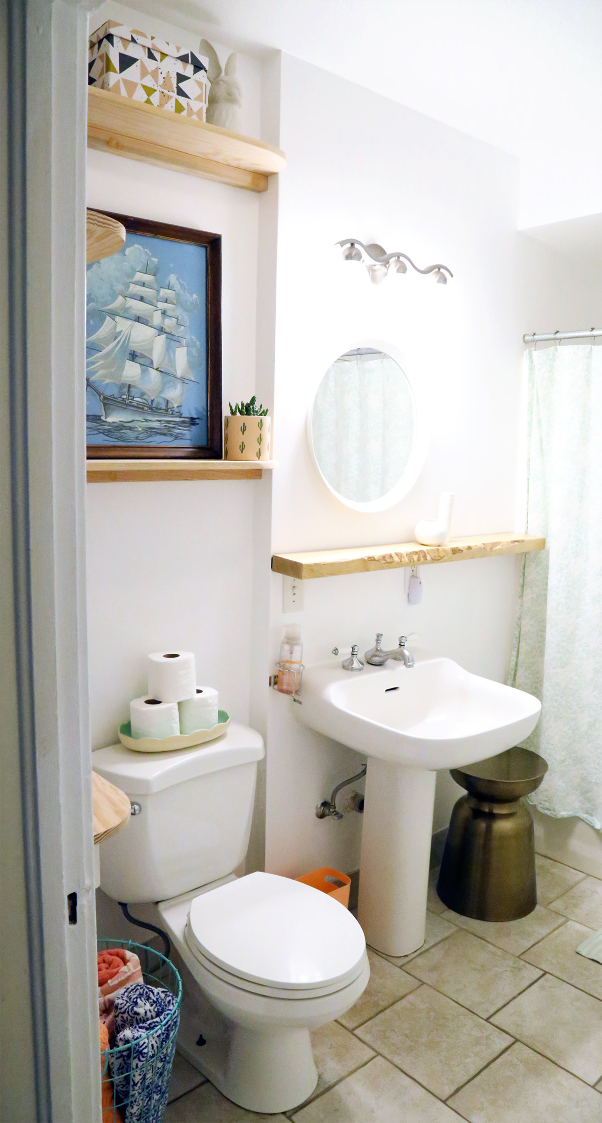 DIY floating shelves in bathroom.