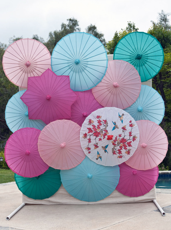 There's a full tutorial on how to build this parasol backdrop, from A Subtle Revelry.