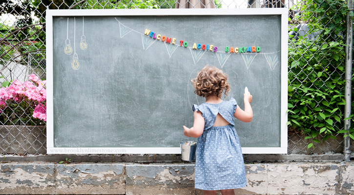 My daughter doesn't really like drawing with chalk on our walkways (we do have chickens walking around bugging her), so this framed outdoor magnetic chalkboard would be perfect! We could attach it to our fence and she can draw away. Found on My Colortopia.