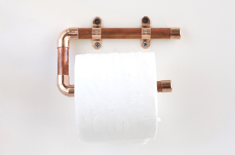 Copper pipe toilet paper roll holder, from Kristi Murphy.