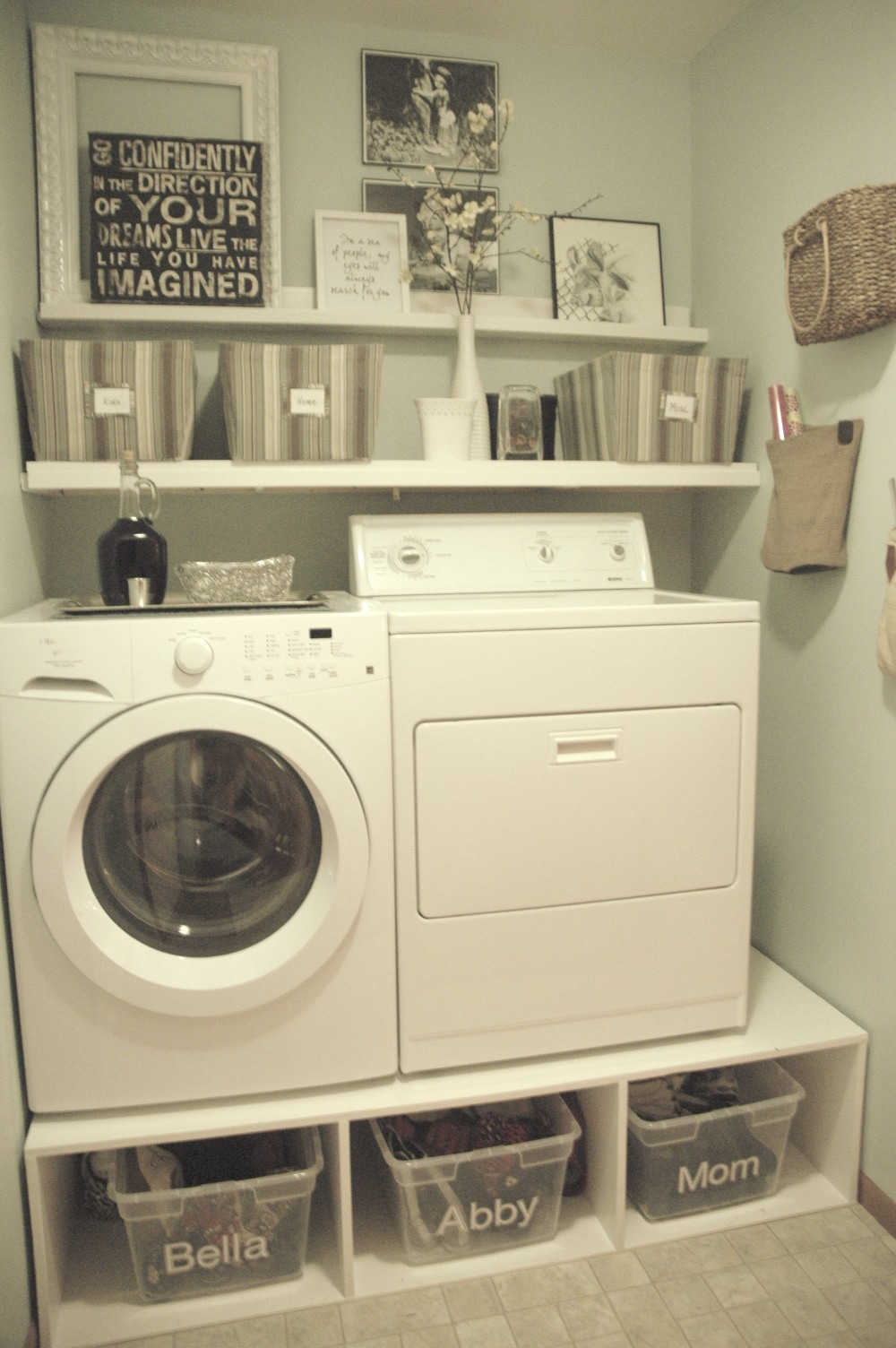 This laundry room makeover makes me so happy! This blogger made her own pedestal to create more storage under the washer and dryer. I must do this in my laundry room! Found on Tremendously Thrifty.