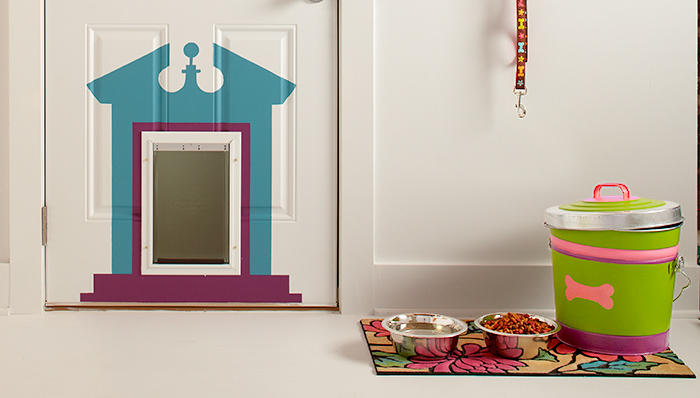 Dress up your doggy door with a little paint to create a faux frame! Found on the Lowes blog.