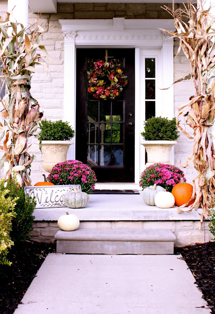 This front door set up is just lovely. Found on The Yellow Cape Cod.