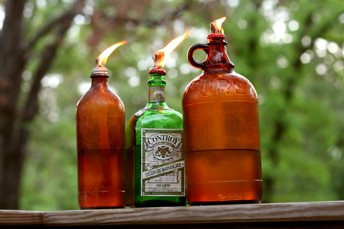 Vintage bottle mosquito repellant lanterns, from Yeah Vintage.