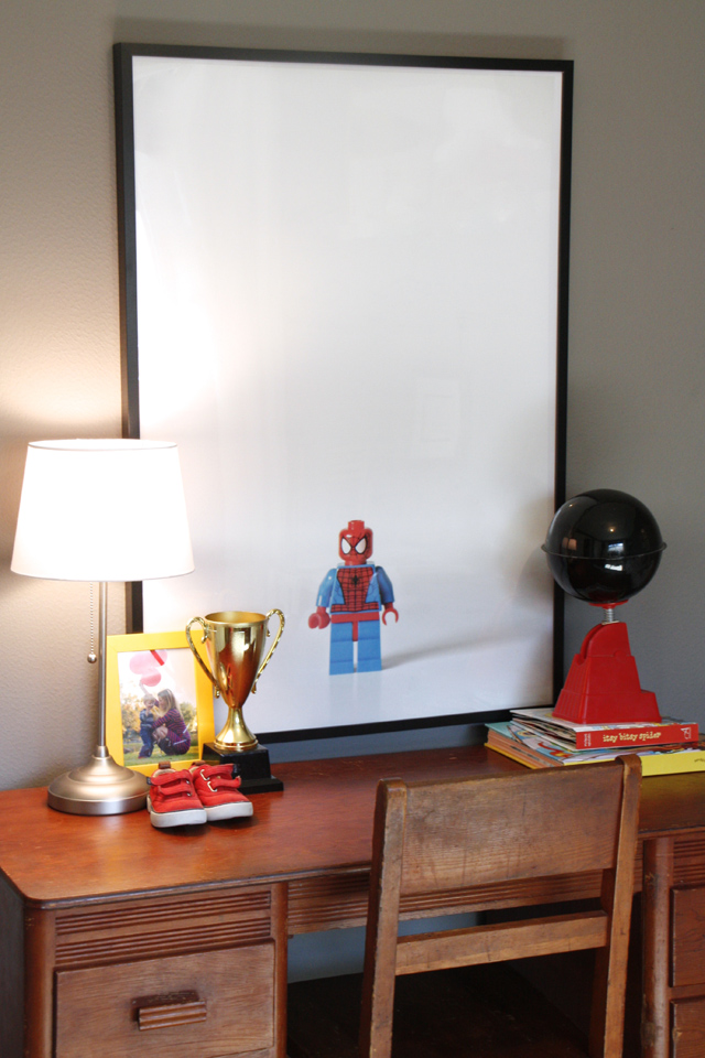 Don't spend a ton on artwork for the kids room. You can make your own with your kids favorite toy, a white backdrop, and a camera. Found on Modern Parents Messy Kids.