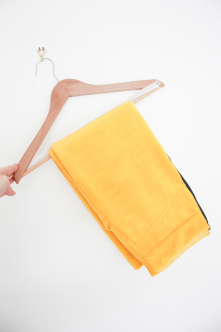 You can easily make this non slip pant hanger with a bit of elastic. No more pants slipping off and onto the floor! Found on Live Free Creative.