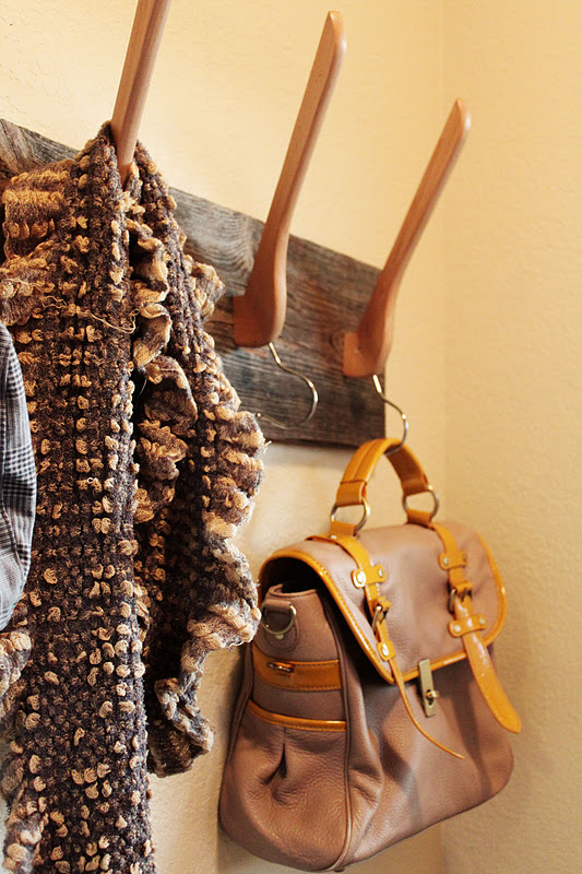 Use multiple wooden hangers to create a coat and purse rack for your front entry, from A Little Glass Box.