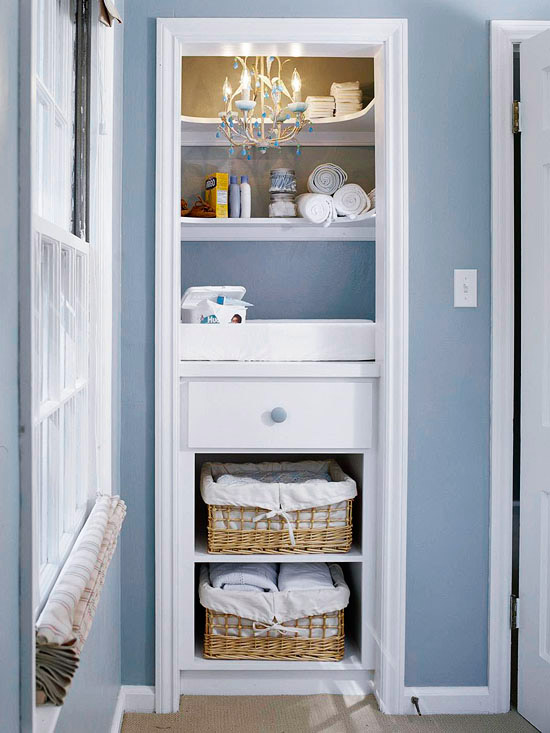 Turn a small closet space into the whole diaper changing space, along with other baby storage, from BHG.