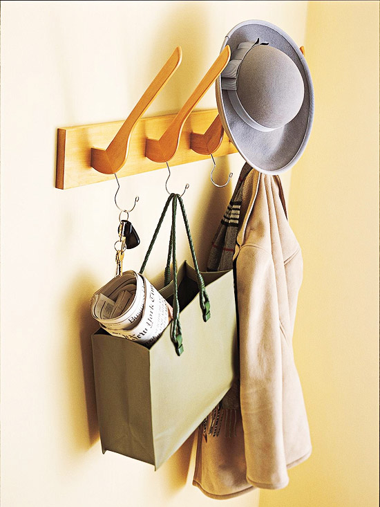 Learn how to make this fun wooden hanger coat rack for your front entry. Found on BHG.