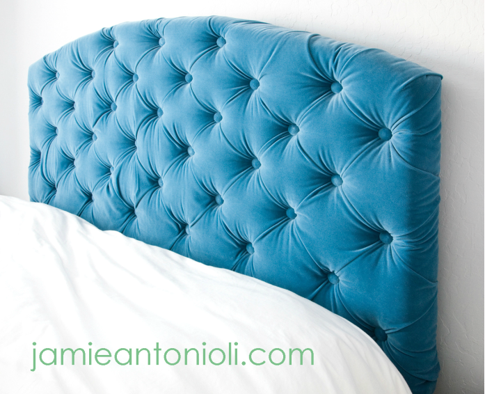 This tufted headboard is magnificent! The full DIY is on Schue Love.