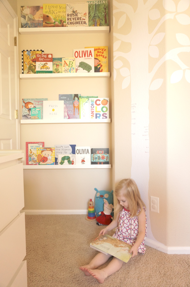 Most of us have that little space right behind the door that is not used for anything. Why not use it? This is a clever way to organize those kid books in a small space. Found on Yellow Bliss Road.