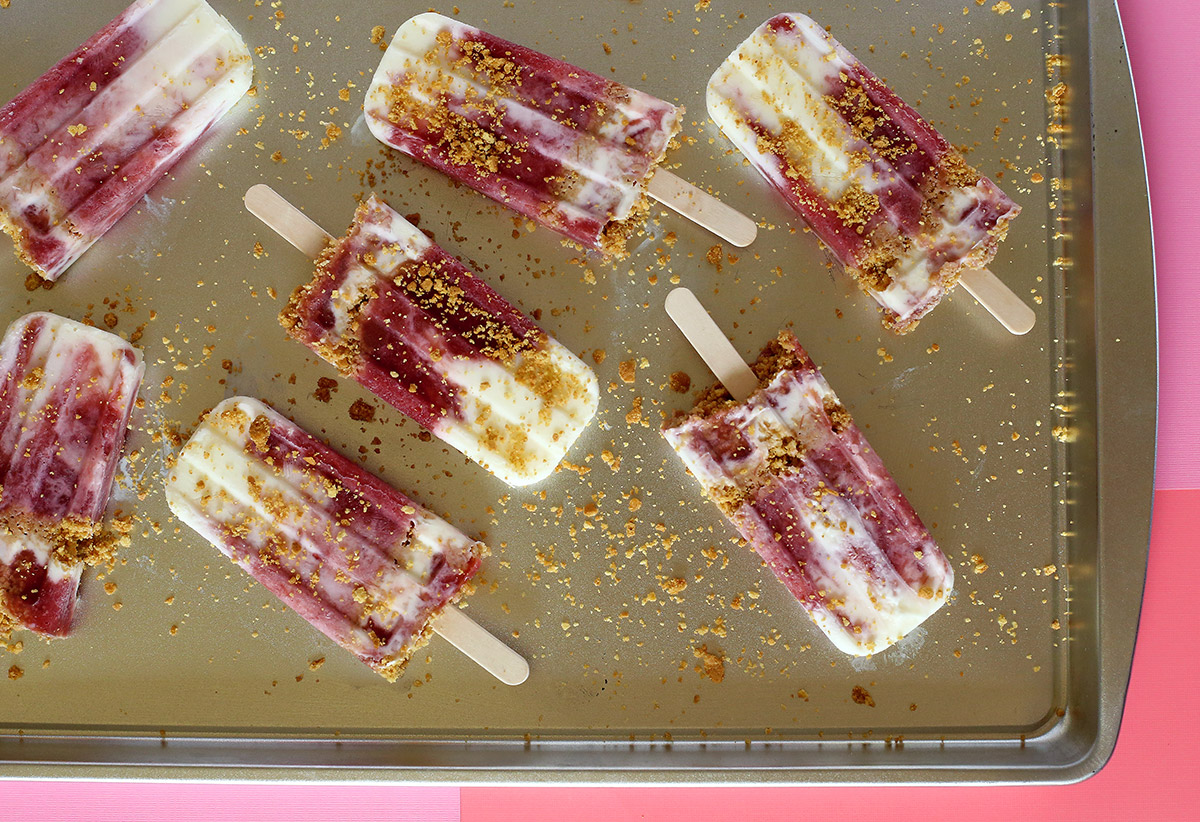Aerial view of Strawberry Rhubarb Yogurt Crumble Pops on a baking sheet.
