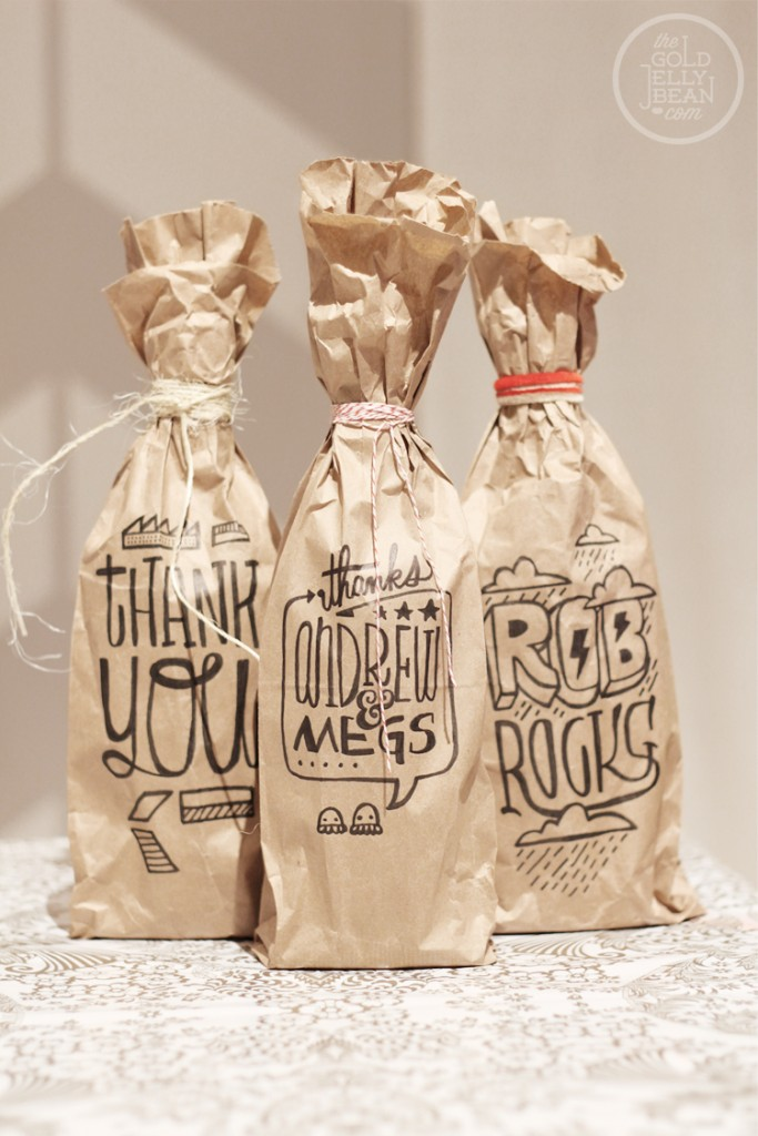 3) I love making gift bags out of paper bags. Wrap up a nice bottle of wine in a customized printed paper bag and you're done, on The Gold Jellybean.