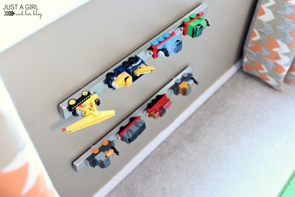 Those small toys always fall to the bottom of the toy bin and are hard to find. You can organize little metal toys on the wall using a magnetic knife rack! Found on Just A Girl and Her Blog.