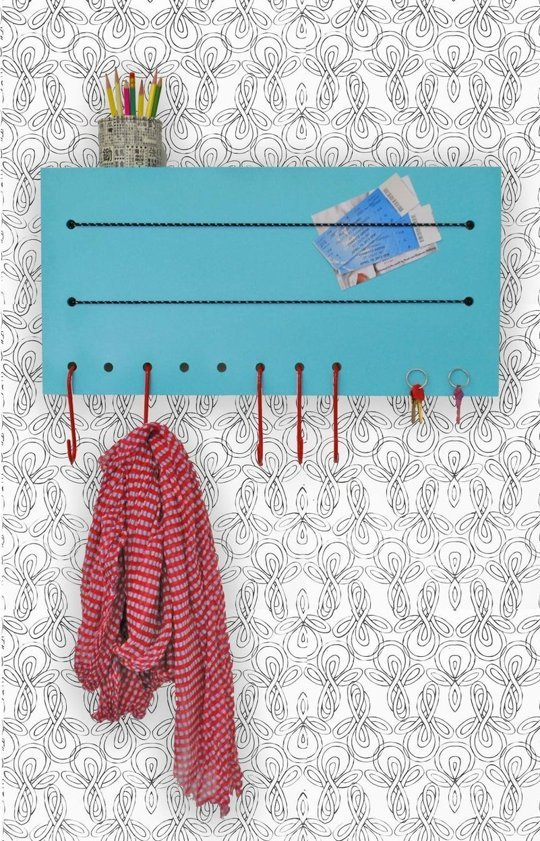 Wall organizer with mail holder straps and coat hooks, from Apartment Therapy.