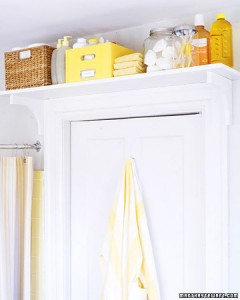 Make use of all the space in your bathroom. Add a shelf above the door. Found on Martha Stewart.