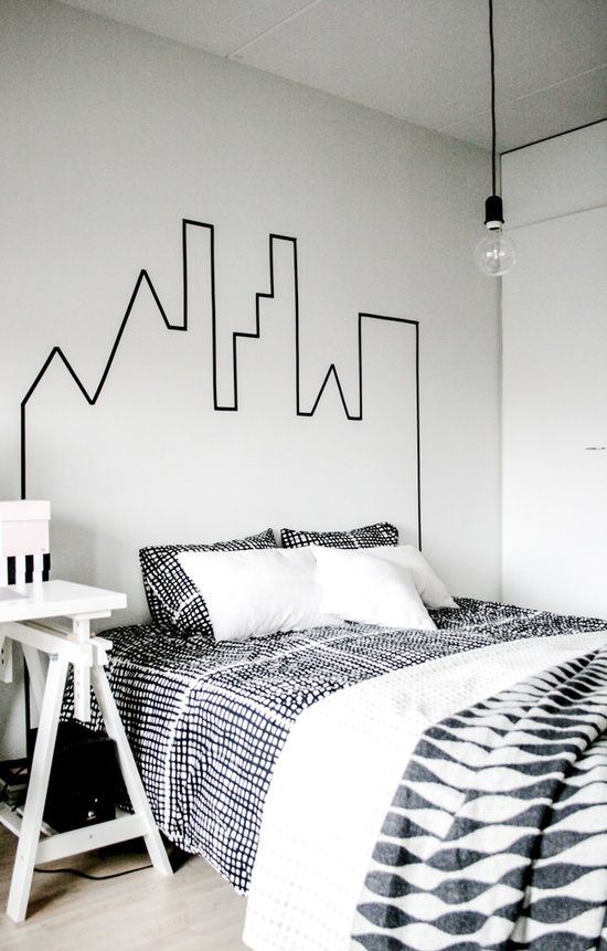 Use washi tape to create a cityscape for a faux headboard. Found on Charlotte Minty.