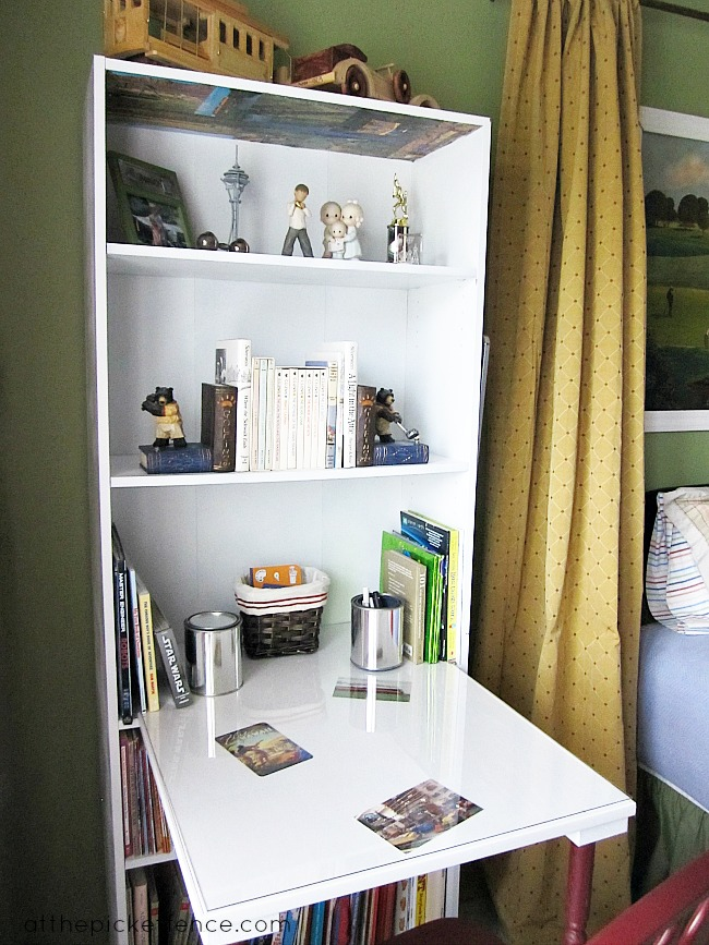 All you need to create this small office space: a bookcase, two table legs, and a tabletop, from At The Picket Fence.