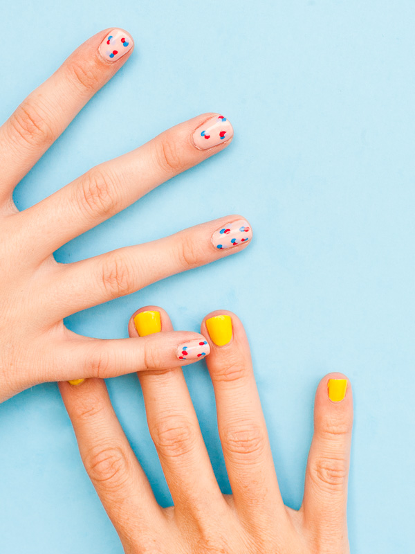 I'll definitely being trying these DIY Polka Dot nails. Found on the Paper n Stitch blog.