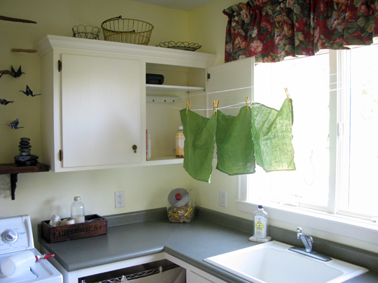 If you do have some cabinet space and need a spot to hang clothes, this DIY retractable clothesline is so cool. Check out how she did it on Just About Home.
