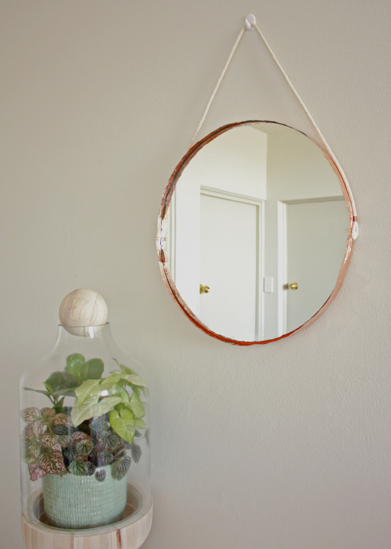 Hang this pretty copper edged mirror in your front entry, from Makers Society.